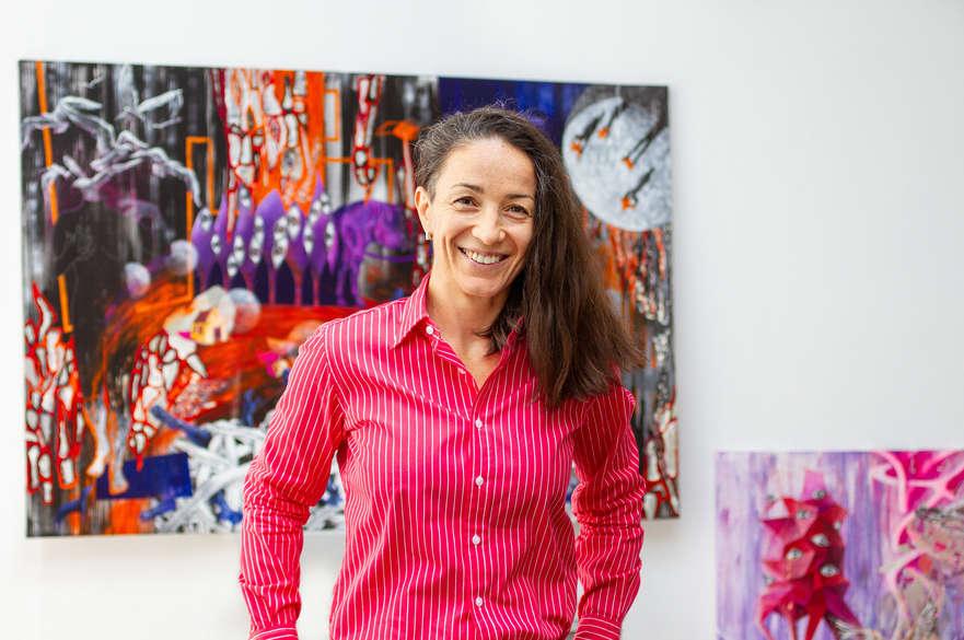 Postgraduate student in front of her artwork