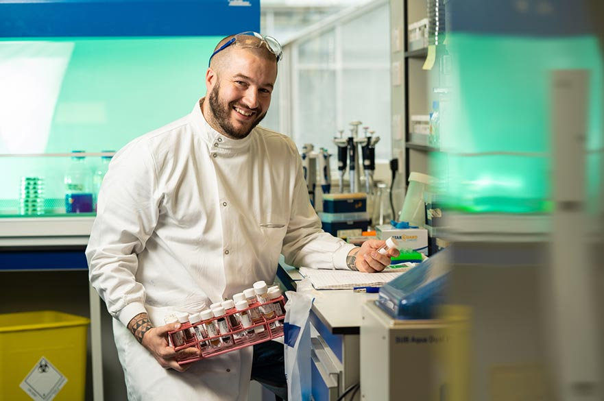 Biosciences PhD student in lab