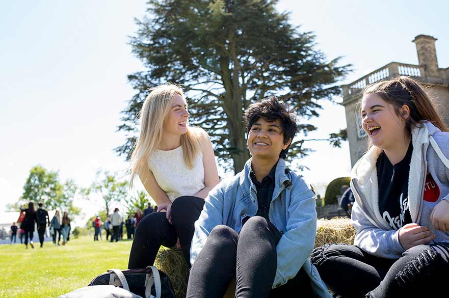 Students sat on hay bale