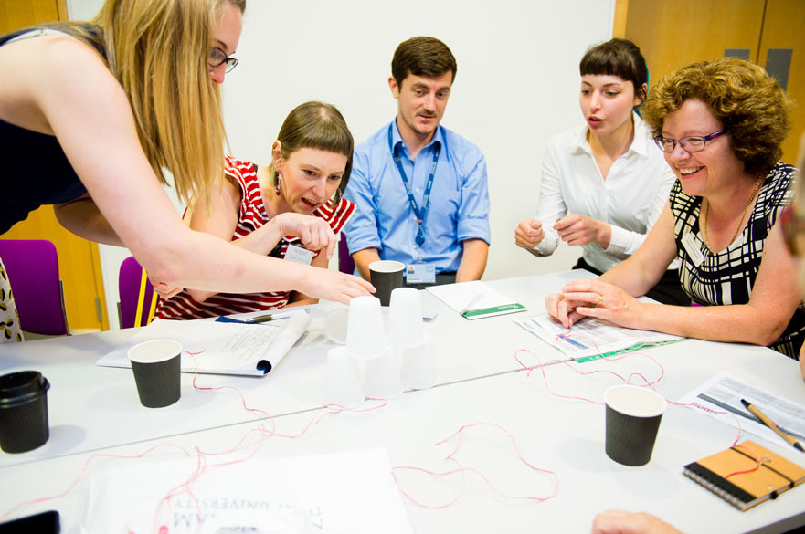 People working in a group around a table