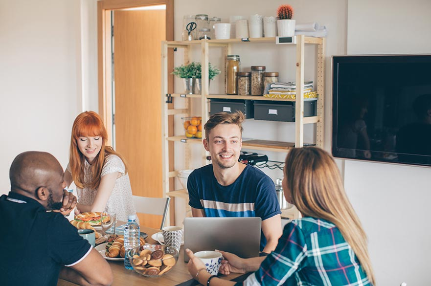 Postgraduate students in kitchen