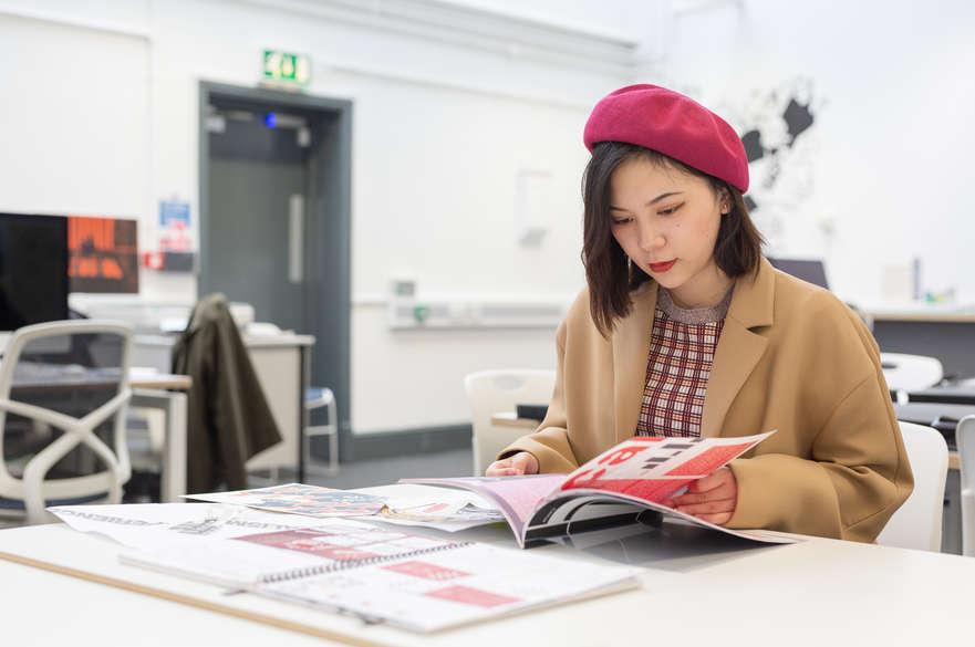 Postgraduate Magazine Journalism student reading a magazine.