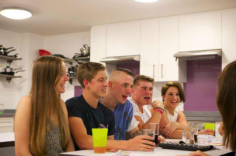 Happy students in NTU residence kitchen