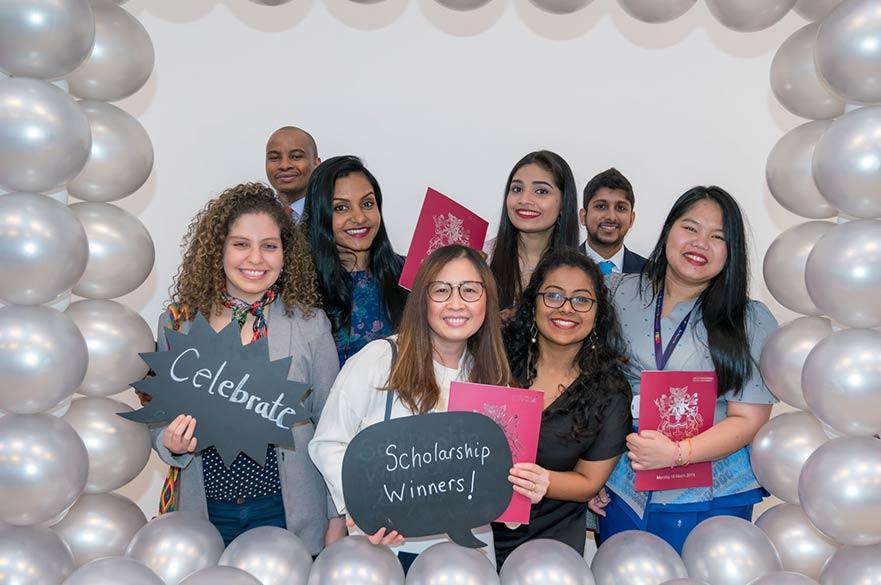 Postgraduate Scholars celebrating